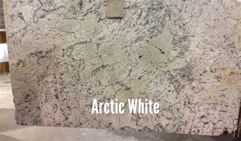 Granite Countertops For White Kitchen Cabinets by Arctic White