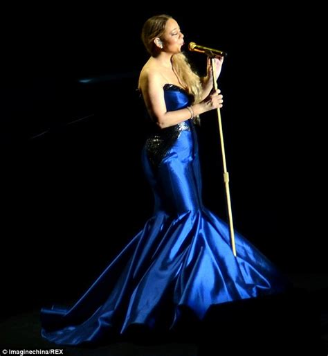 Dress Mic Mol carey busts out of black dress performing in china daily mail