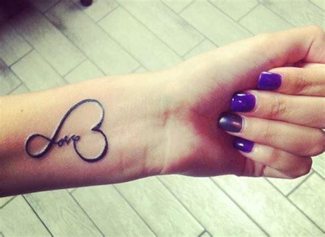 love tattoo on hand design of tattoosdesign of tattoos