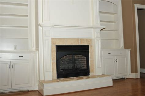 built in fireplace cabinets built in cabinets flanking fireplace home