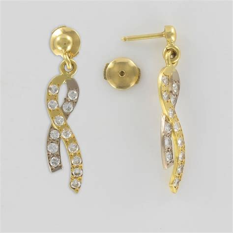 Gold Ribbon Earring modern two gold ribbon and earrings for sale at 1stdibs