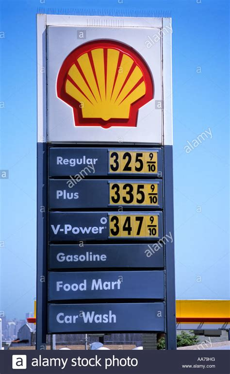 """Shell ""gas station"" sign, showing price of three ^US dollars per Stock Photo, Royalty Free"