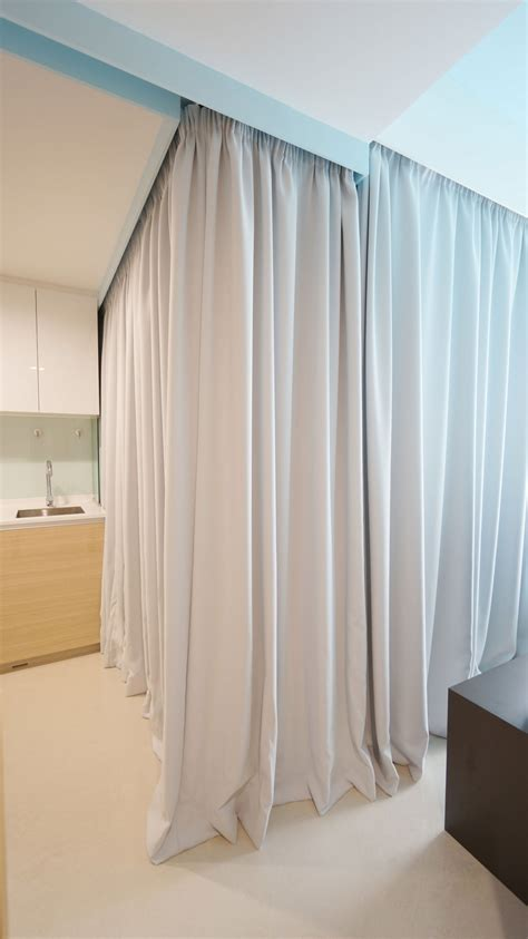 curtains to divide room tiny apartment uses fabric curtains to divide its spaces