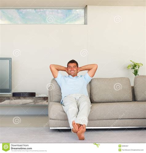 relaxing on the couch royalty free stock photography young man relaxing on a