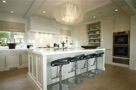Crystal Chandelier Over Kitchen Island To Add Luxury To
