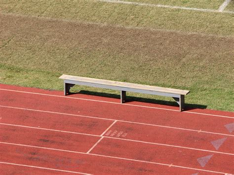 bench and field track free stock photo an empty bench on a track field