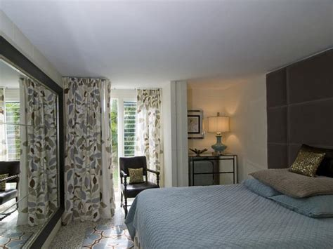 transitional style bedroom in brown with blue a bold small traditional neutral bedroom hgtv
