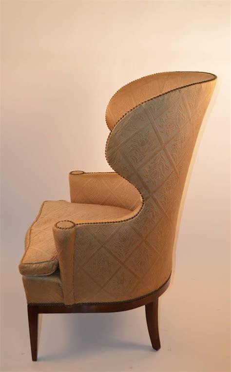 stylish barrel back wing chair at 1stdibs
