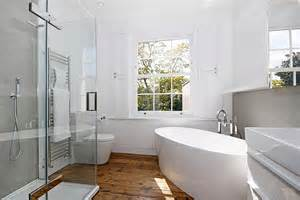 Contemporary bathroom in white with standalone tub decoist