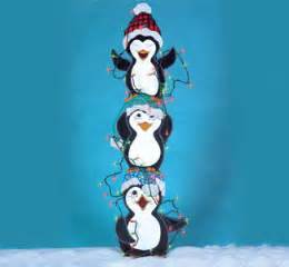 christmas tangled trio of penguins with lights wood by