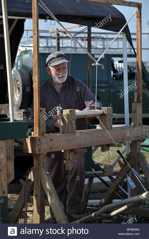 An Old Man Wood Turning On An Old Fashioned Lathe At The