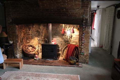 Tudor Interior Design forge cottage fireplace and stove smaller east meon history