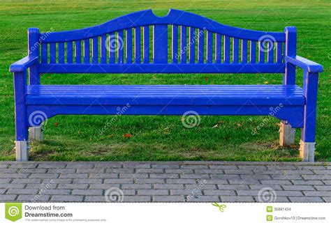 blue wood bench blue wooden bench on green grass stock images image