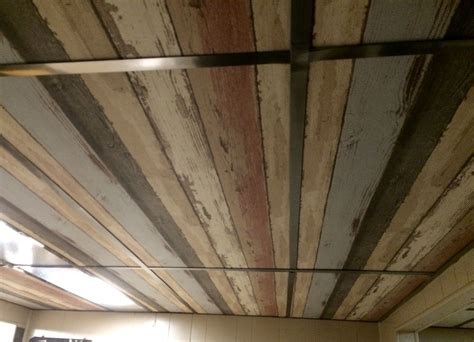 how to tile a ceiling dropped ceiling i wallpapered the ceiling tiles i