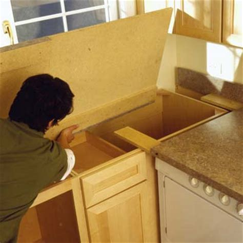 Installing Kitchen Countertops Laminate by Attach The Countertop To The Cabinet How To Laminate A Countertop This House
