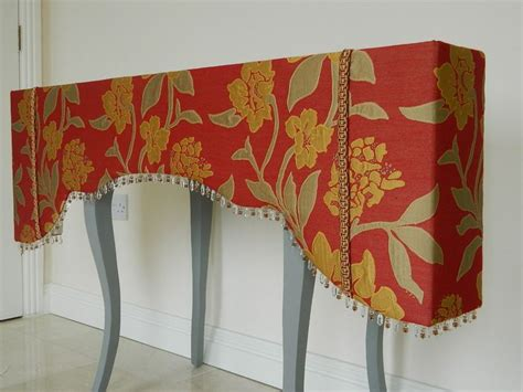 Shaped upholstered pelmet with beaded trim   Curtain and