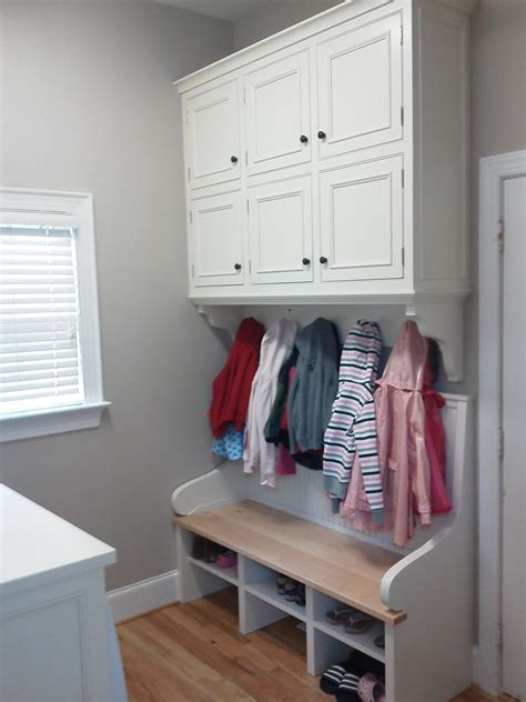 bench for laundry room hand made built in laundry room cabinets and bench by