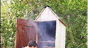 tom smokes striped bass in his homemade smokehouse