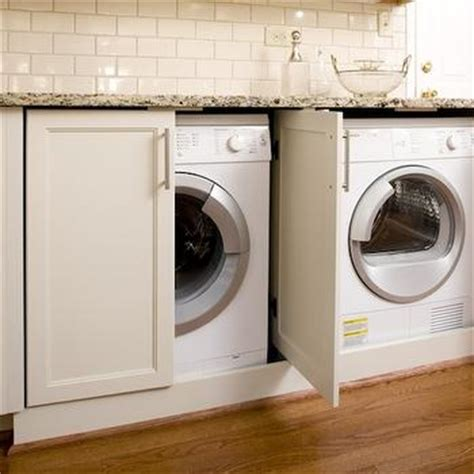 cabinet doors to hide washer and dryer white laundry room cabinets traditional laundry room