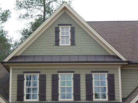 Natural stone, shake, shutters, metal roofing   Craftsman