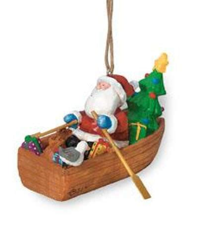 santa delivering gifts in dory boat holiday christmas ornament