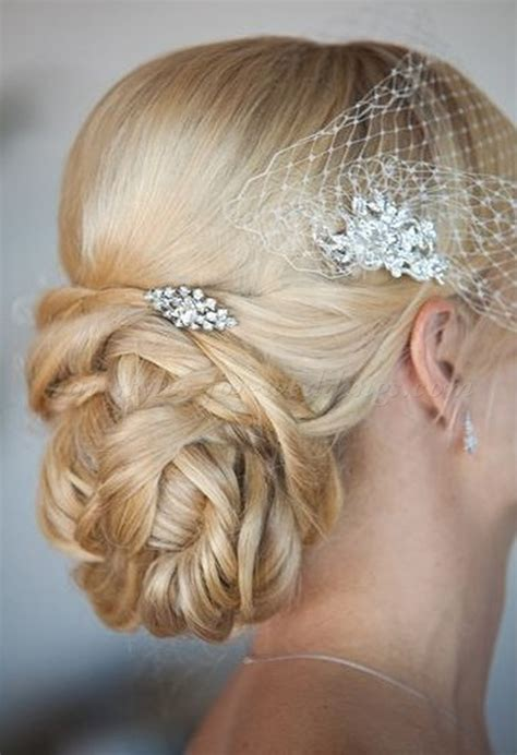 wedding hair updos with birdcage veil low bun wedding hairstyles chignon with birdcage veil