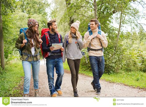 Friends On by Of Smiling Friends With Backpacks Hiking Stock Photo