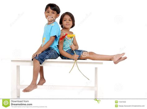 sister company of bench brother and sister enjoying on bench stock photo image