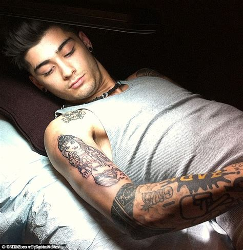 gigi hadid teases fans with shirtless snap of zayn malik
