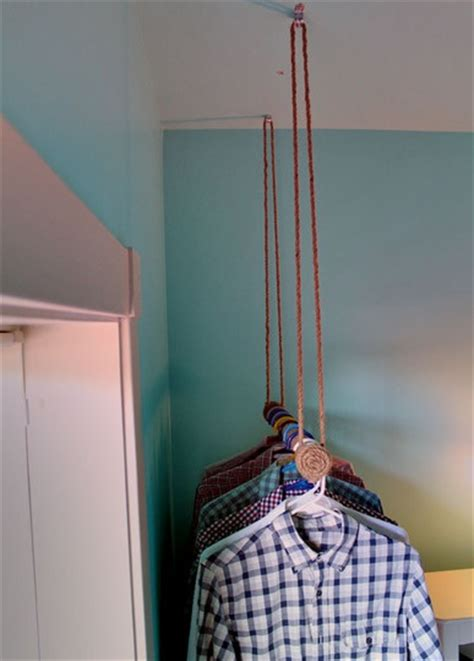 Hanging Clothes Rod From Ceiling by 1000 Ideas About Hanging Storage On Vacuum