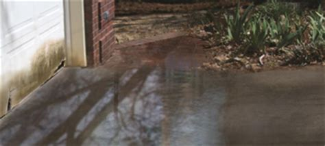 fix standing water in your driveway