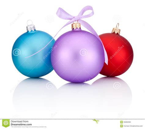 three christmas balls red blue and purple with ribbon bow