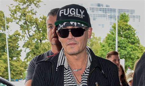 johnny depp so johnny fotolog johnny depp greets fans while arriving at poland airport