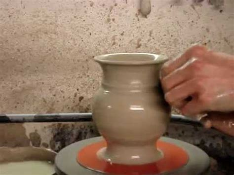 throwing a pot throwing a pottery jug throw a clay pot pitcher on the