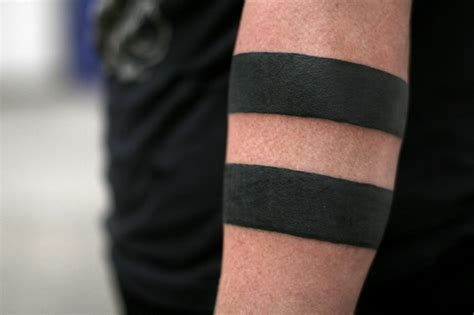 thick line black band tattoo on forearm tattooimages biz