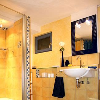 bathrooms with yellow walls the bath showcase bathroom decorating ideas