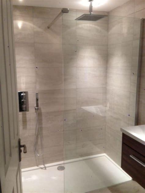 light grey stone tiles   large walk  shower