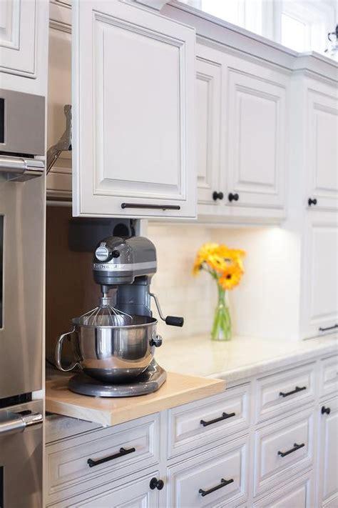 kitchen appliances cabinet with gray garage door