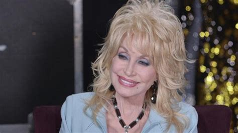 does dolly parton have tattoos it s true dolly parton admits she has tattoos larry