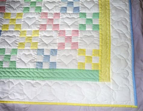 Tiny Cabin amish infant quilt in a traditional nine patch pattern