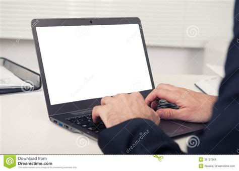 what desk is using rear view of business using laptop stock photo