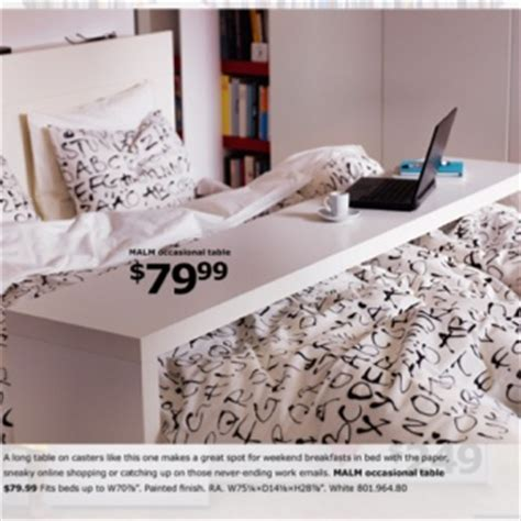 over the bed table ikea these are so awesome they can be at the head of the bed the end of the bed or