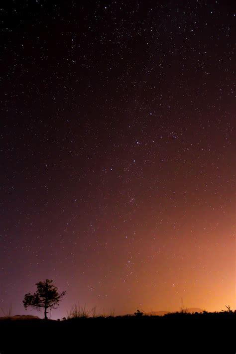 black  orange night sky photo  dimitris adalialis