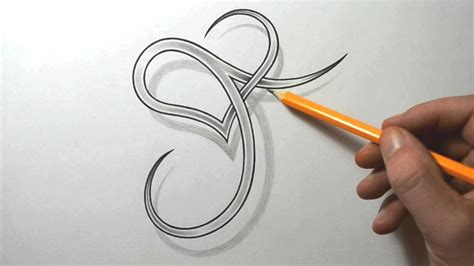j tattoo design designing a stylized j with a letter
