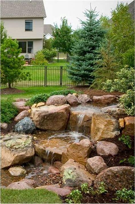 rustic backyard waterfalls ideas   outdoor