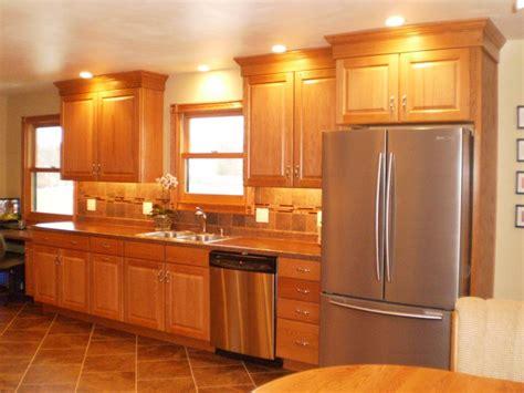 oak cabinets luxury vinyl floor tile tile backsplash and stainless appliances shuman kitchen