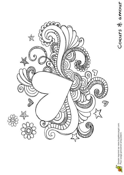 Un joli cœur entouré d'étoiles et de fleurs à colorier et