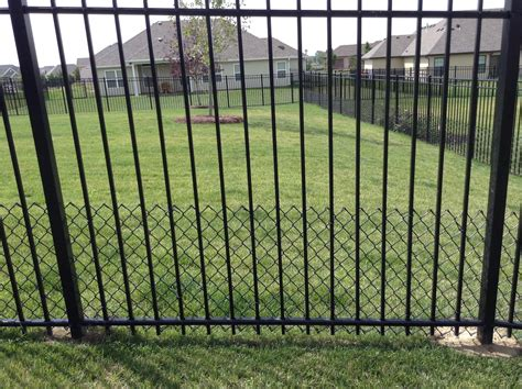 puppy fence 2 simple solutions for puppy proofing your fence ornaco fence