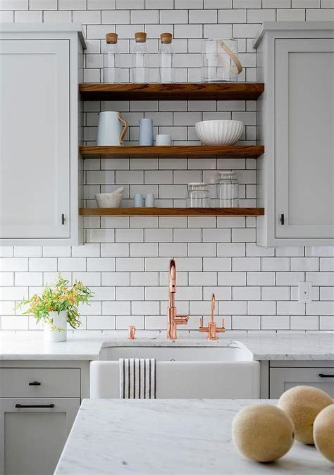 copper farmhouse sink with white cabinets light gray and white kitchen boasts a farmhouse sink