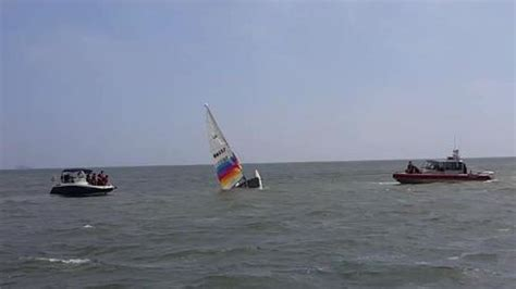 catamaran boat flips sailor given ride to shore after boat flips 3 times near